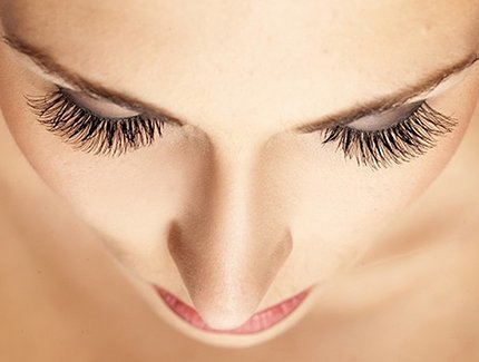 Close up photo of women who looks great thanks to having her eyelashes done by a make up artist.