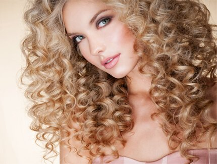 Image of women from Colorado who just got a wonderful perm done to her hair