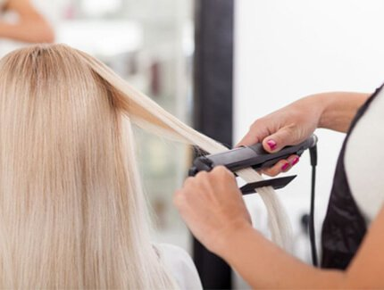 Lady at the salon having yuko hair straightening done to her hair.