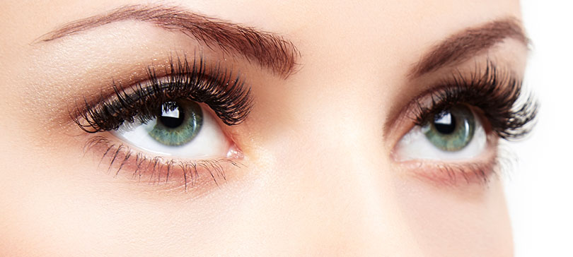 Close up photo of women who looks great thanks to having her eyelashes done by a make up artist