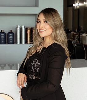 Portrait of Eva Martinez, hair stylist at HQ Salon